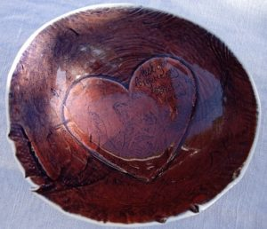 """Red Porcelain bowl by John Bauer South Africa handmade in South Africa with inscription """"lest you forget my love, porcelain lasts forever"""" and featuring a beautiful heart"""